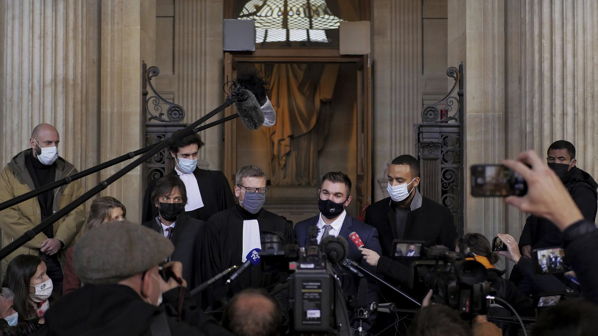 Alek Skarlatos, center right, Anthony Sadler, right, Mark Moogalian, left, and their lawyer...