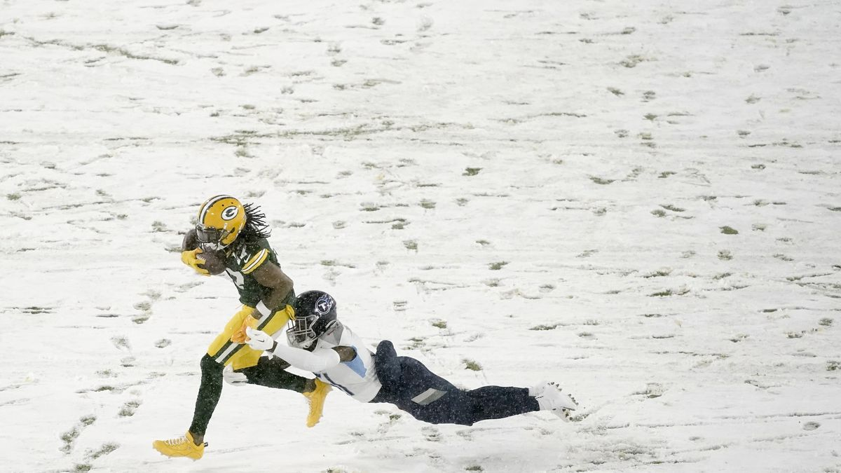 Green Bay Packers' Davante Adams tries to get past Tennessee Titans' David Long during the...