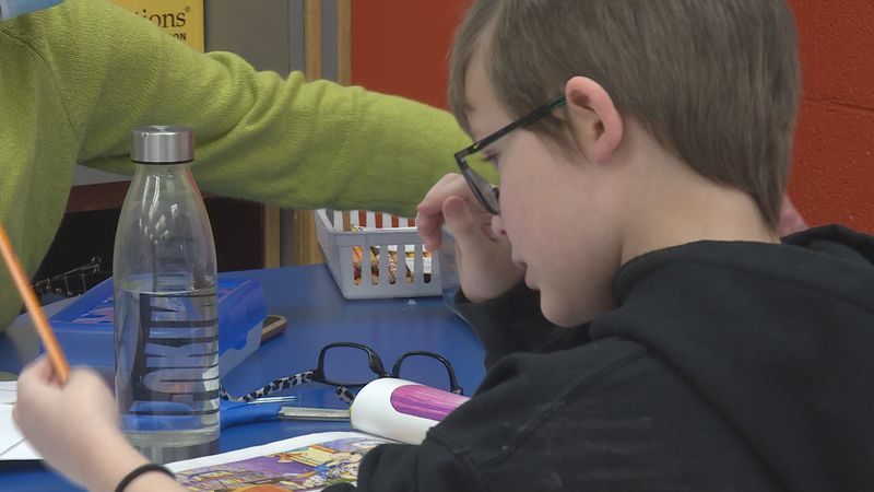 Student concentrated on school work at Clinton Elementary School