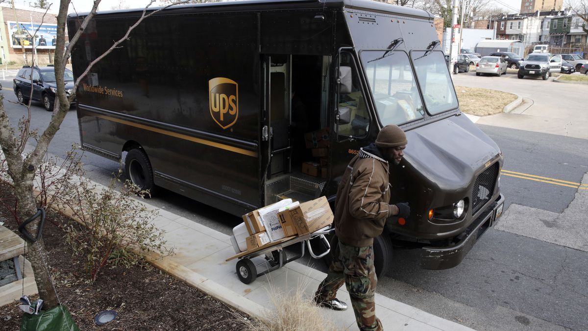 FILE - In this Dec. 19, 2018, file photo a UPS driver prepares to deliver packages in Baltimore. UPS said Monday, Sept. 9, 2019, that it expects to hire about 100,000 seasonal workers and pay them more to handle the avalanche of packages shipped between Thanksgiving and Christmas. (AP Photo/Patrick Semansky, File)
