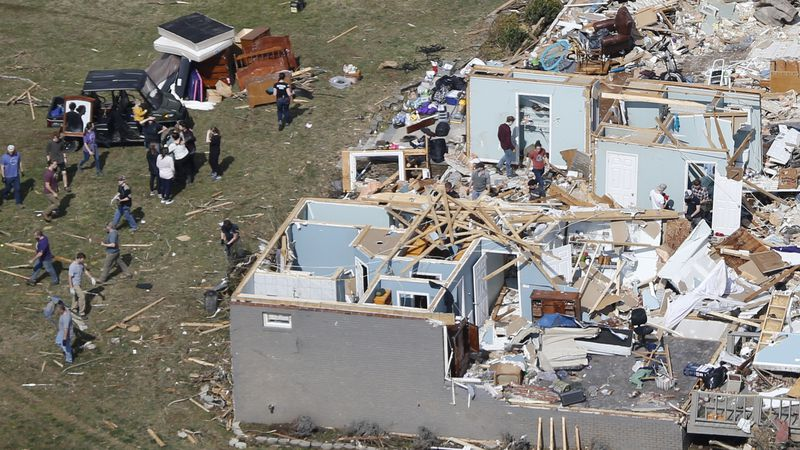 People work to salvage items Tuesday, March 3, 2020, near Cookeville, Tenn. Tornadoes ripped...
