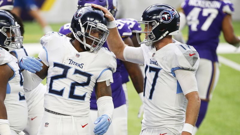 Tennessee Titans running back Derrick Henry (22) celebrates with teammate Ryan Tannehill,...