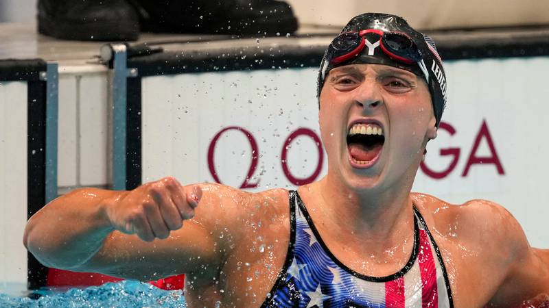 Katie Ledecky, of the United States, reacts after winning the women's 1500-meters freestyle...