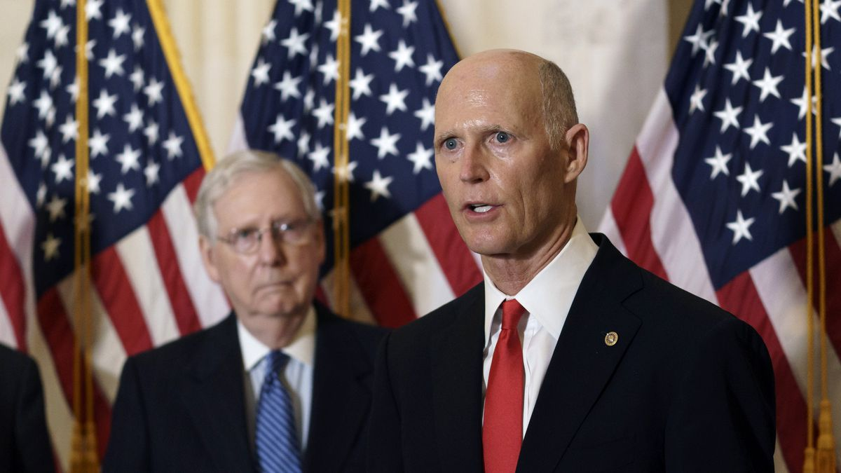 Sen. Rick Scott, R-Fla., joined at left by Senate Majority Leader Mitch McConnell, R-Ky.,...