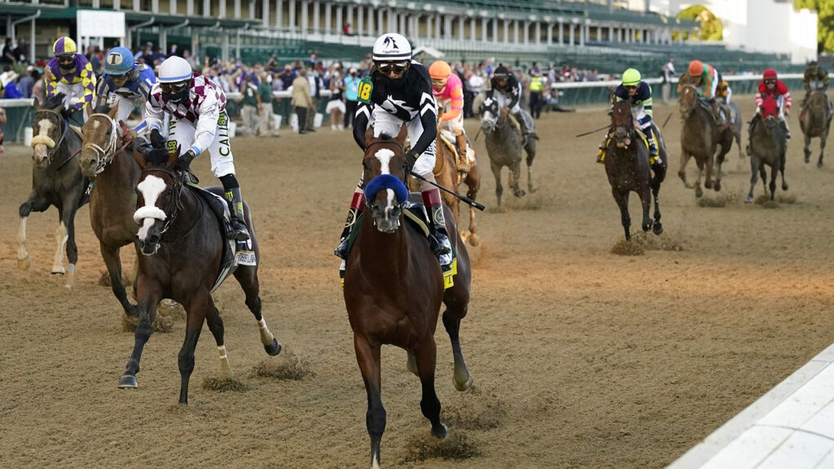 Jockey John Velazquez riding Authentic (18) crosses the finish line to win the 146th running of the Kentucky Derby at Churchill Downs, Saturday, Sept. 5, 2020, in Louisville, Ky. (AP Photo/Jeff Roberson)