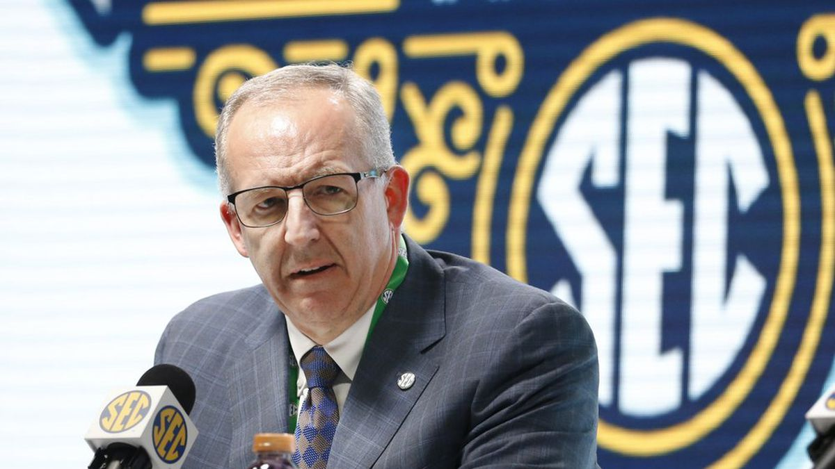 In this March 11, 2020, file photo, Southeastern Conference Commissioner Greg Sankey speaks at a press conference in Nashville, Tenn. The Power Five conferences spent $350,000 on lobbying in the first three months of 2020, more than they had previously spent in any full year, as part of a coordinated effort to influence Congress on legislation affecting the ability of college athletes to earn endorsement money. The Southeastern Conference was the biggest spender, hiring three lobbying firms and paying them a total of $140,000, according to lobbying disclosure forms reviewed by The Associated Press. (AP Photo/Mark Humphrey, File)