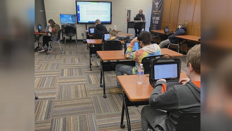 Kids in classroom at JMS; virtual students sit in as well