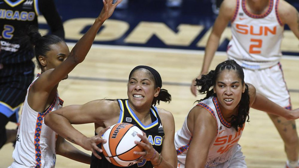 Chicago Sky forward Candace Parker, center, makes her move against the defense of Connecticut...