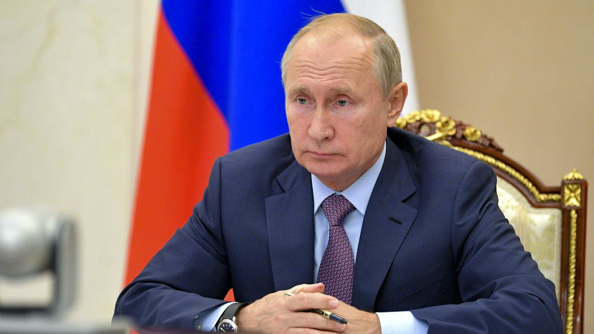 Russian President Vladimir Putin chairs a Security Council meeting via video conference in...