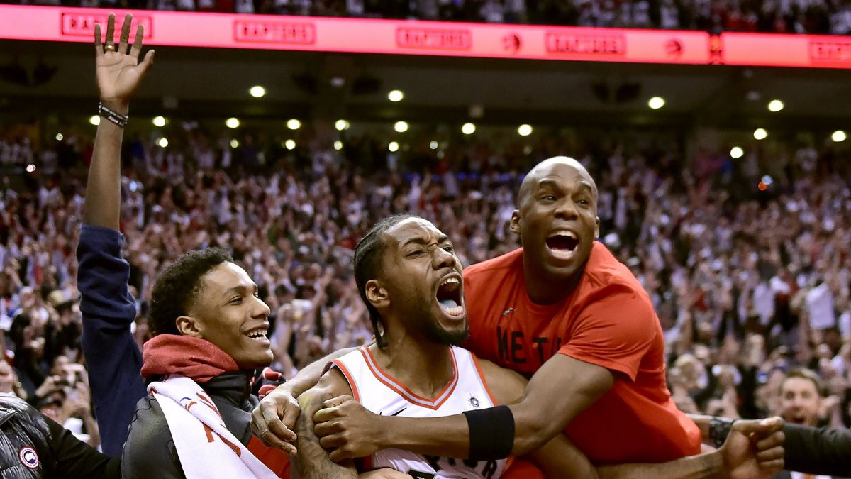 Toronto Raptors forward Kawhi Leonard (2) celebrates his last-second basket with teammates at the end of the second half of an NBA Eastern Conference semifinal basketball game against the Philadelphia 76ers in Toronto on Sunday, May 12, 2019. (Frank Gunn/The Canadian Press via AP)