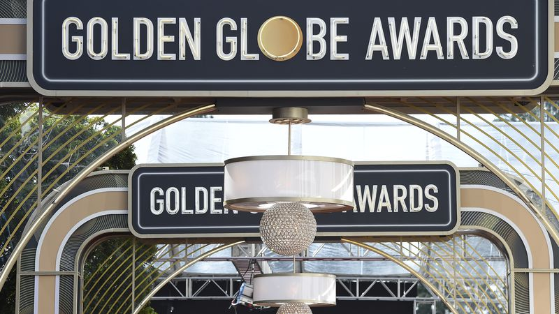 Event signage appears above the red carpet at the 77th annual Golden Globe Awards, Sunday, Jan....