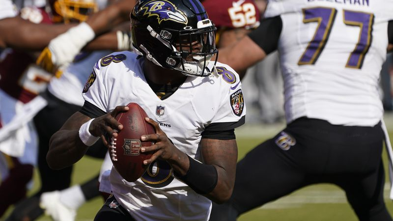 Baltimore Ravens quarterback Lamar Jackson (8) works in the pocket against the Washington...
