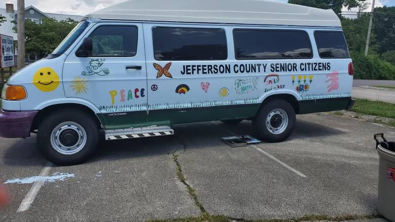 Seniors painting van in Jefferson City.