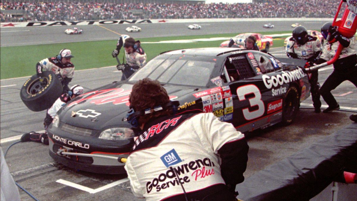 The Goodwrench pit crew works to change two tires during Dale Earnhardt's final pit stop prior...