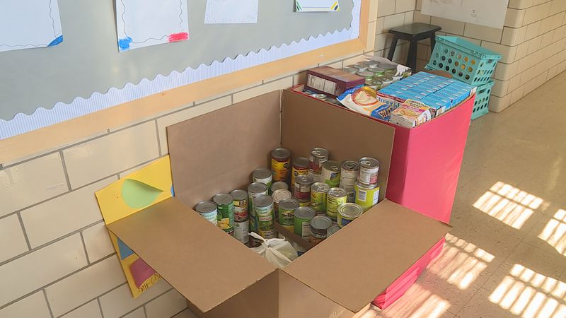 Students collect items for food drive in which items will go in blessing box