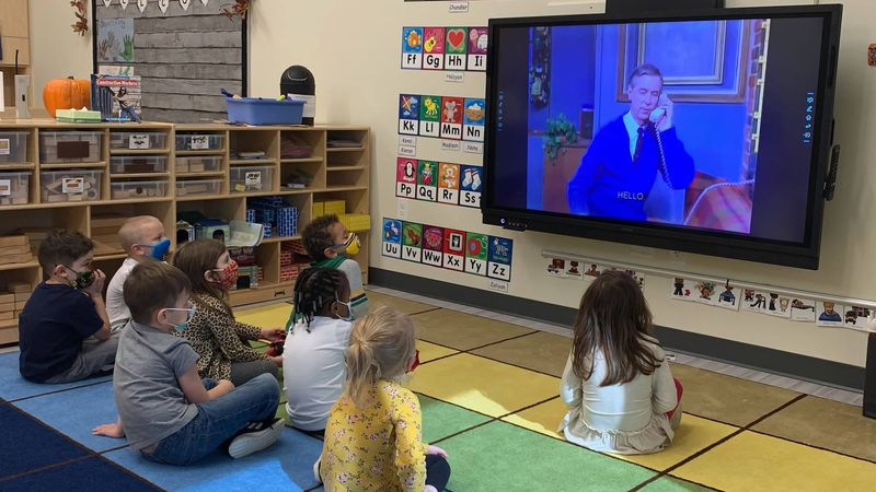 Preschoolers practice kindness with vintage Mister Rogers lessons on World Kindness Day.
