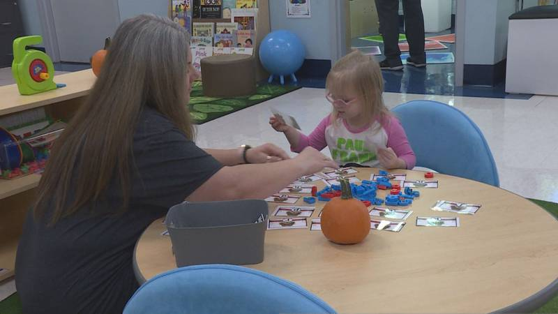 Student learns letters in Amanda Woody's blended preschool class
