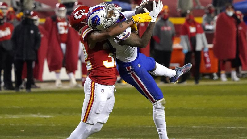 Buffalo Bills wide receiver Stefon Diggs is tackled by Kansas City Chiefs safety Tyrann...