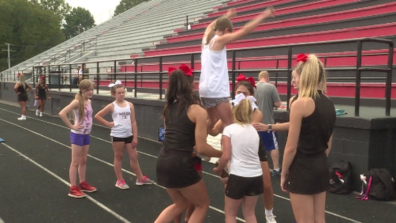 Knoxville Central High School cheerleaders teaching during Sunday's skill clinic.