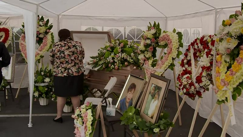 A funeral is held for a COVID-19 victim in a South Los Angeles parking lot. COVID-19 has taken...