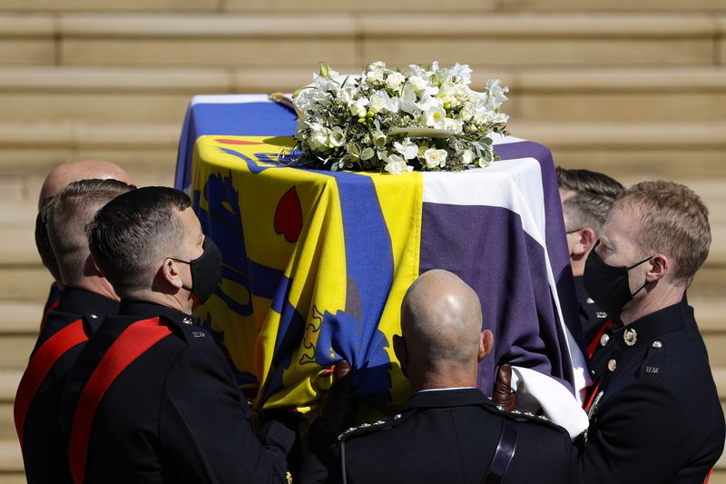 The coffin arrives at St George's Chapel for the funeral of Britain's Prince Philip inside...