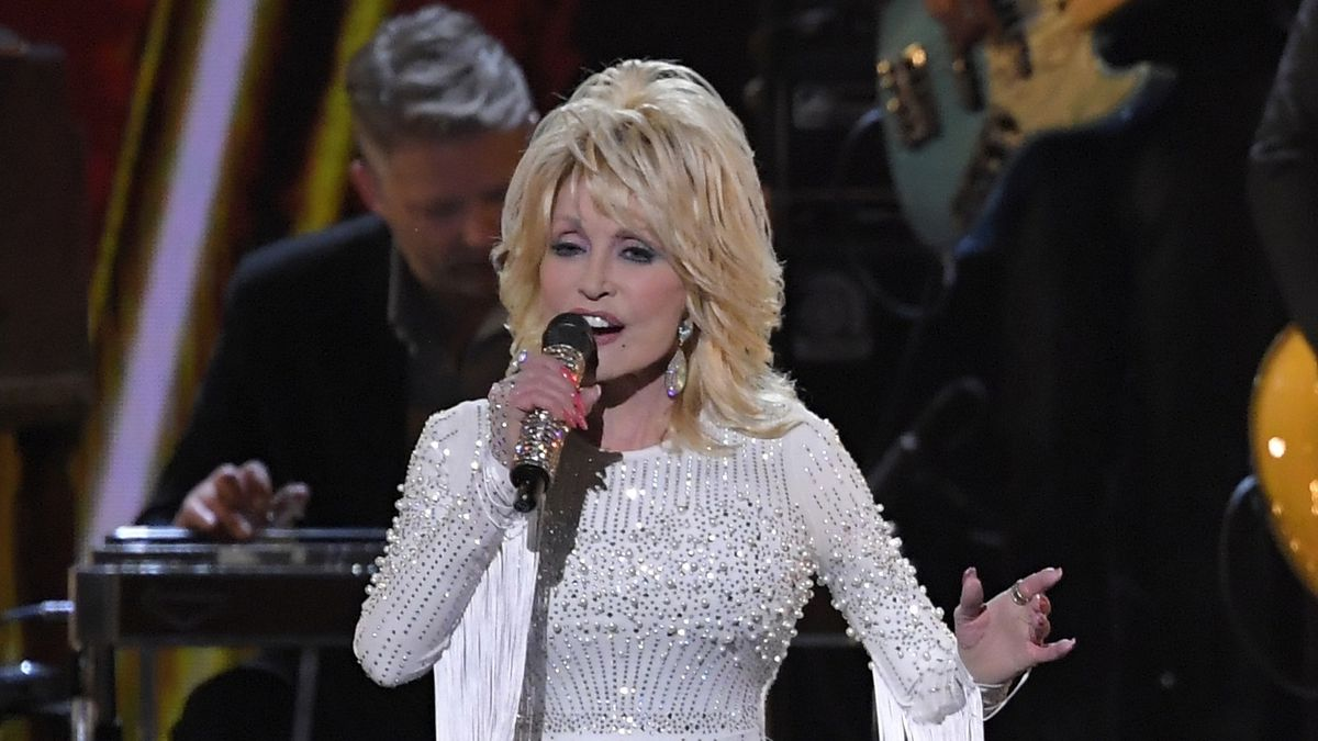 FILE - This Nov. 13, 2019 file photo shows Dolly Parton performing at the 53rd annual CMA...