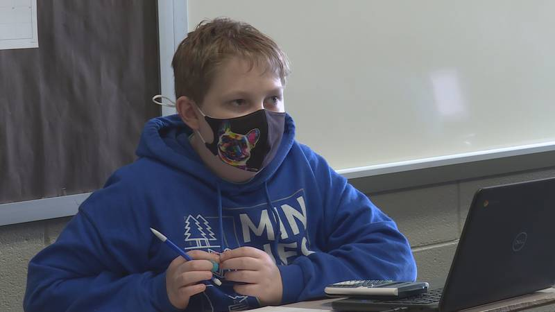 Student wears mask in a classroom