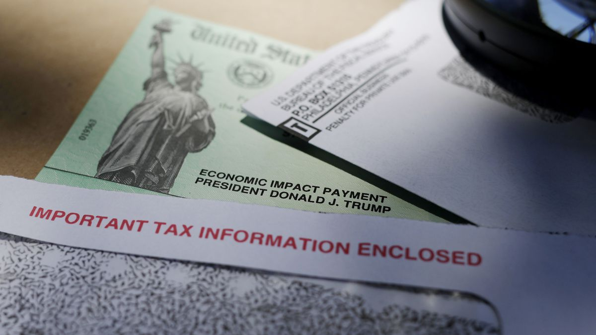 FILE - In this April 23, 2020, file photo, President Donald Trump's name is seen on a stimulus check issued by the IRS to help combat the adverse economic effects of the COVID-19 outbreak. The IRS is sending out catch-up economic impact payment checks to roughly 50,000 people after an error occurred in the rush to send out stimulus payments earlier this year.