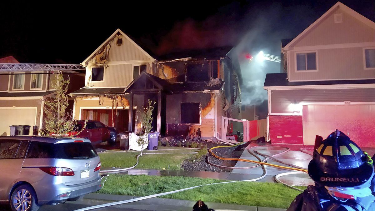 This photo from the Denver Fire Department shows the house where multiple people were found dead in fire that authorities suspect was intentionally set, early Wednesday, Aug. 5, 2020. A Denver Fire Department spokesman says three people who were on the the upper story of the house managed to escape but the fire's heat pushed back a police officer trying to rescue those on the first floor.