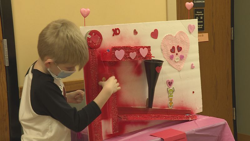 An ESK third grade student explained the simple machines used in his Valentine's Delivery System