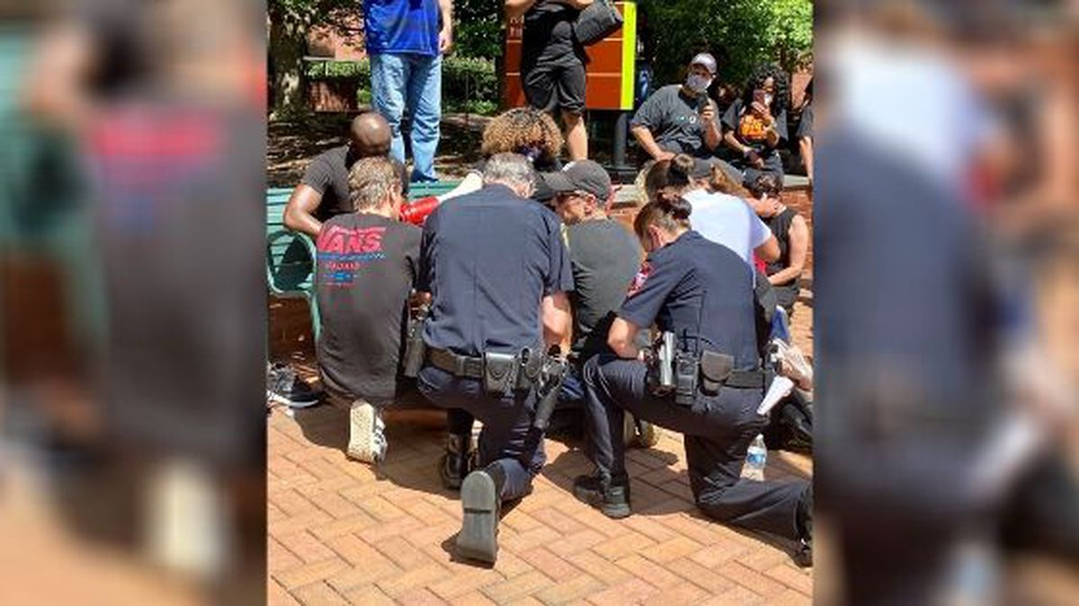 Police in North Carolina have washed the feet of black religious leaders during a prayer walk...
