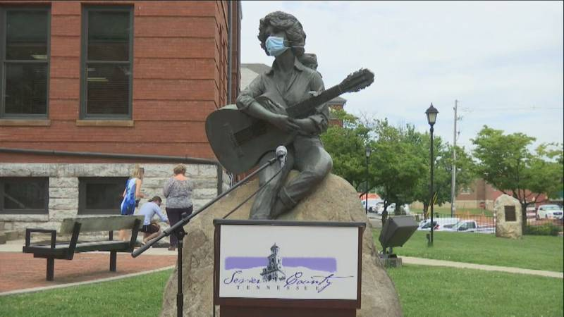 Sevier County Dolly Parton statue wears a mask / Source: (WVLT)
