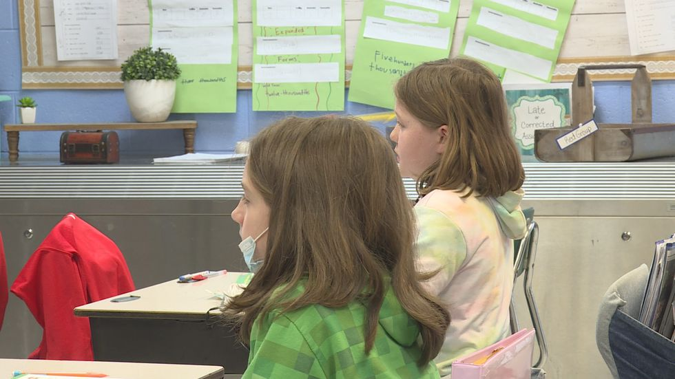 Fifth graders listen to math lesson