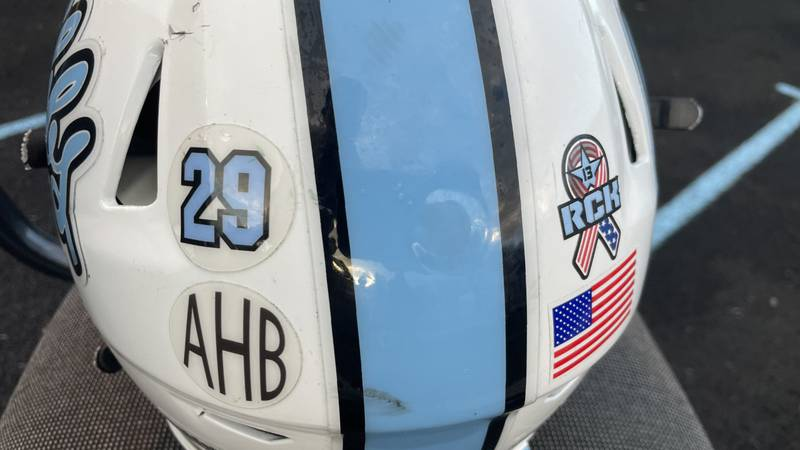Gibbs and Fulton High Schools honored Army Staff Sgt. Ryan Knauss with helmet stickers in their...