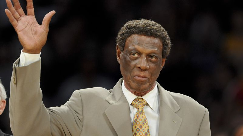 Elgin Baylor waves as is honored along with other members  of the 1974 Los Angeles Lakers...