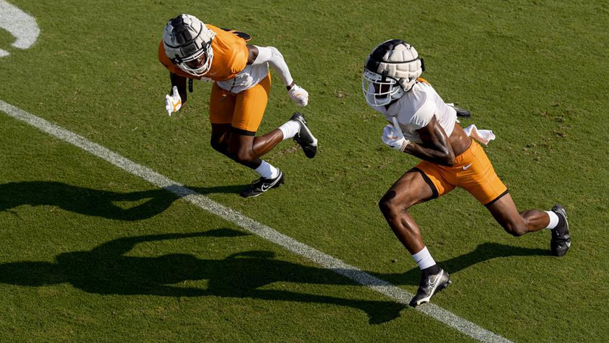 KNOXVILLE, TN - August 24, 2021 - Defensive back Warren Burrell #4 and Wide receiver JaVonta...