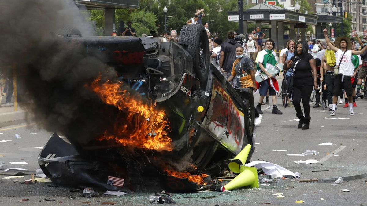 In this May 30, 2020, file photo, protesters demonstrate as a Salt Lake City police vehicle...