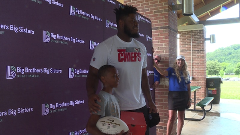 Trey smith standing with a young fan with Big Brothers Big Sisters of East Tennessee.