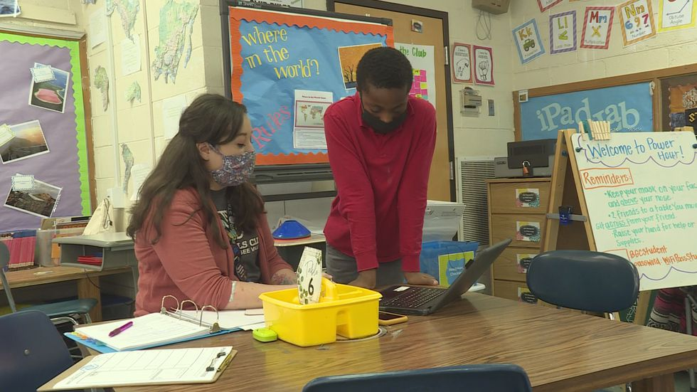 A student works one-on-one with his learning pod teacher