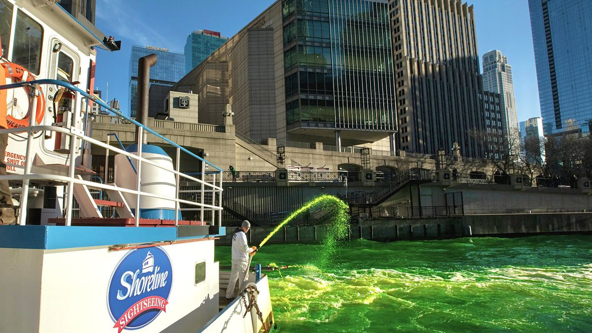 Photo shows the Chicago River as it flows through downtown after it was dyed green in...