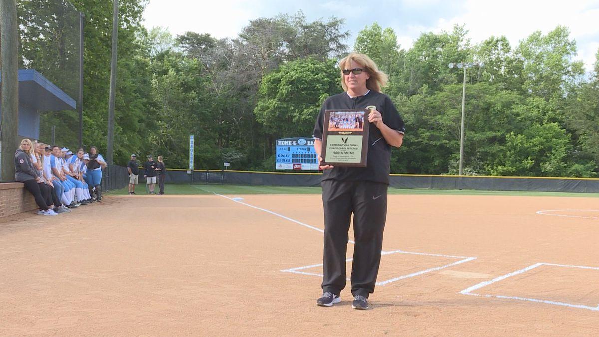 Gibbs softball coach Carol Mitchell is honored for reaching the 900 win milestone.