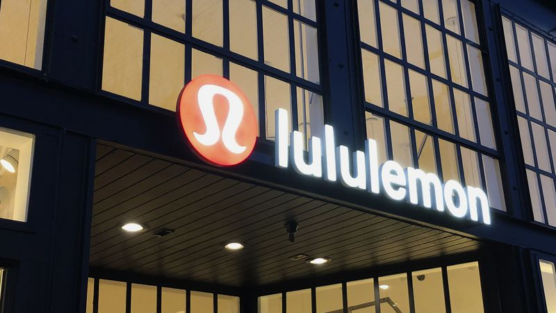 FILE - This Feb. 20, 2020 file photo shows a Lululemon sign in Burlingame, Calif. Athletic...