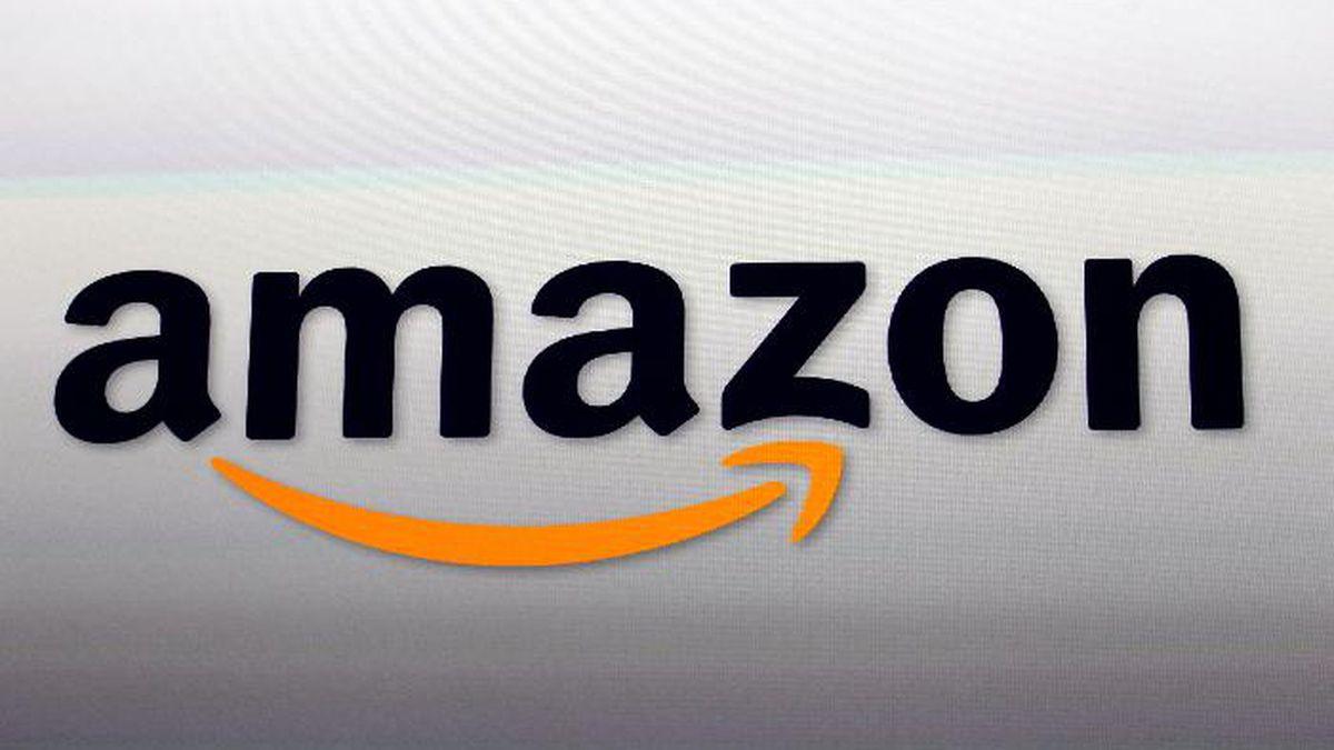 FILE - This Sept. 6, 2012 file photo shows the Amazon logo in Santa Monica, Calif. (AP Photo/Reed Saxon, File)