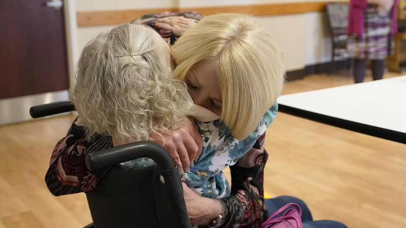 Mary Claire Lane, 86, left, a resident at Hellenic Nursing and Rehabilitation Center, in...