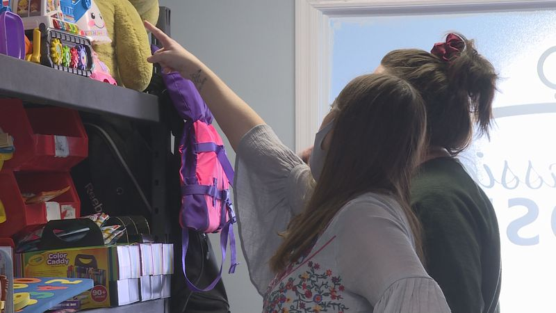 Compassion Closet co-founder Melissa Cox helped a woman select items for her foster children