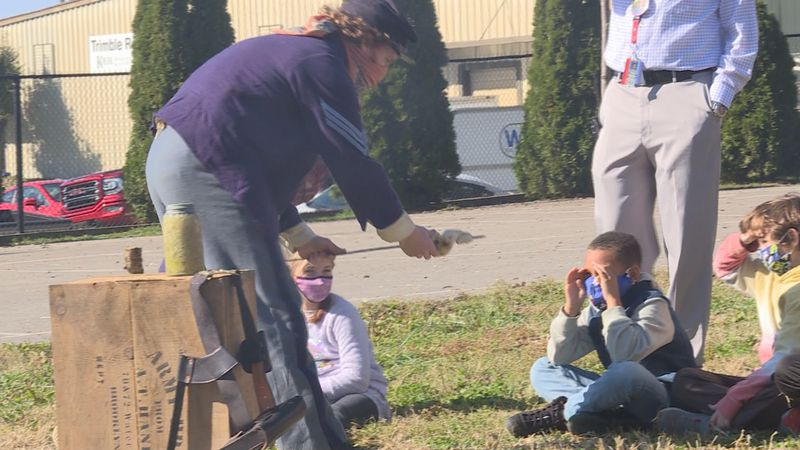 Re-enactor showed students bread he made that would fit for the Civil War time period