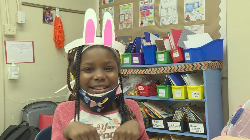 Thrive student makes bunny ears and pretends to be a bunny
