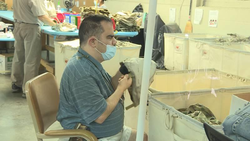 Making helmet covers at Lions Volunteer Blind Industries.