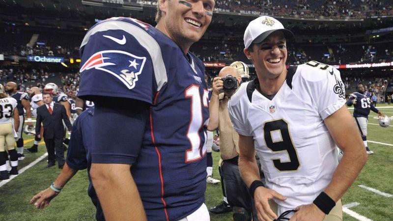 New England Patriots quarterback Tom Brady and New Orleans Saints quarterback Drew Brees greet...