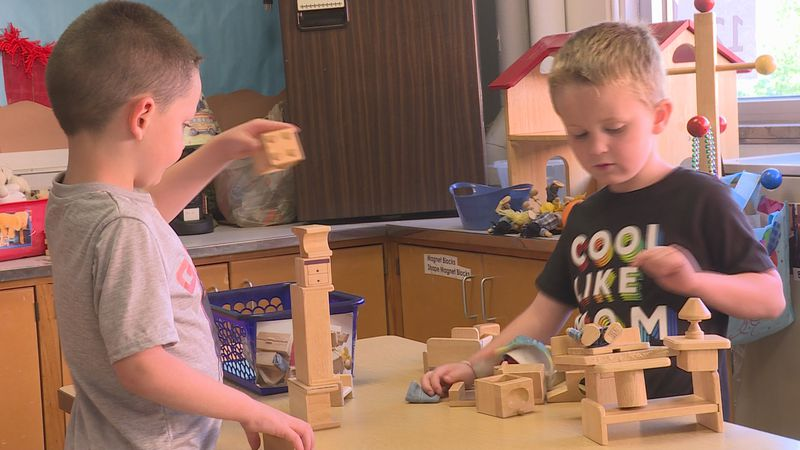 Pre-K students play with blocks